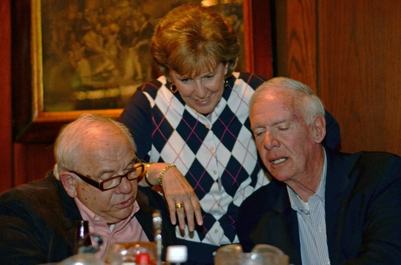 6abc's Cathy Gandolfo (center) looks through photos with longtime KYW reporters, Dick Sheeran (left) and Robin Mackintosh (right) at the Pub in Pennsauken on March 15, 2012. ( Philadelphia Inquirer, March 20, 2012 )