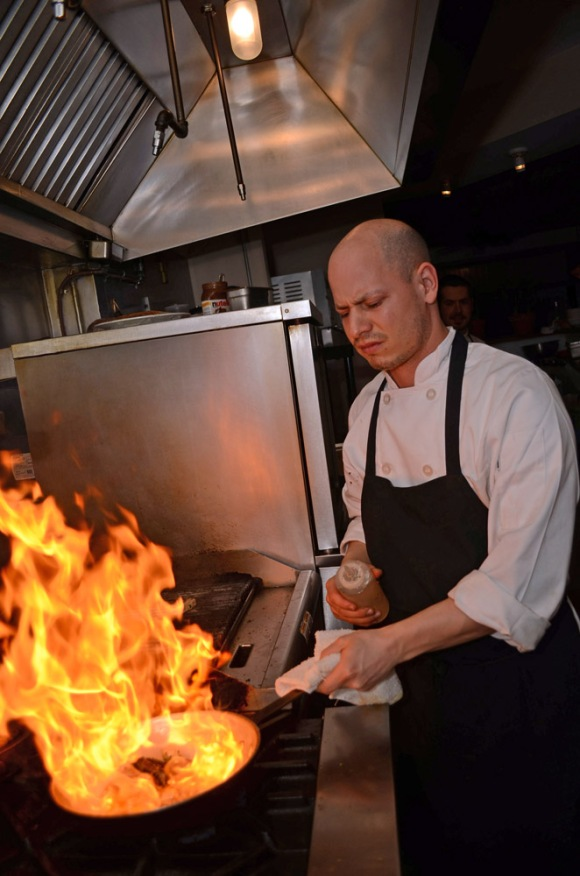 Joe Baldino prepares clams amidst the blaze for his Spaghetti Vongole on March 18, 2012 at Zeppoli's in Collingswood, NJ. ( Philadelphia Inquirer, March 19, 2012 )