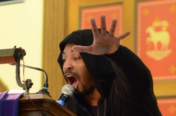 Reverend Micah C.T. Sims preaches at Mount Zion United Methodist Church at 11th and Jefferson wearing a hooded sweatshirt in remembrance of Trayvon Martin. ( Philadelphia Inquirer, March 26, 2012 )