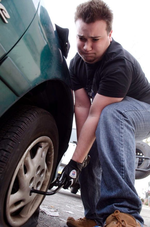 Nick F. Naselli changes one of two slashed tires on Aldine St. in Mayfair. ( Philadelphia Inquirer, February 20, 2012 )