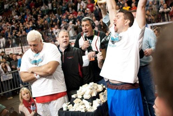 Super Squibb (right) was crowned the 19th Annual Wing Bowl Champion, beating El Wingador (left) by a single wing. ( NBC Off the Bench, February 4, 2011 )